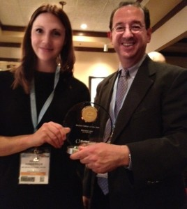Dr Bernard Jaar receiving the 'Section Editor of the Year' award from Dr Hayley Henderson