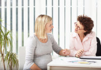 Woman consulting pregnant woman