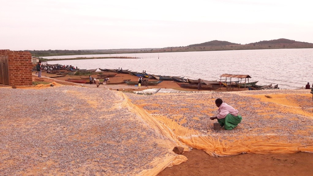 Fishing is a big part of the Bugoto community as can be seen from nets laid out and the fishing boats in the photo. Photo credit: Dr Poppy Lamberton