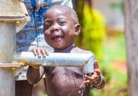 Young_african_child_playing_with_water