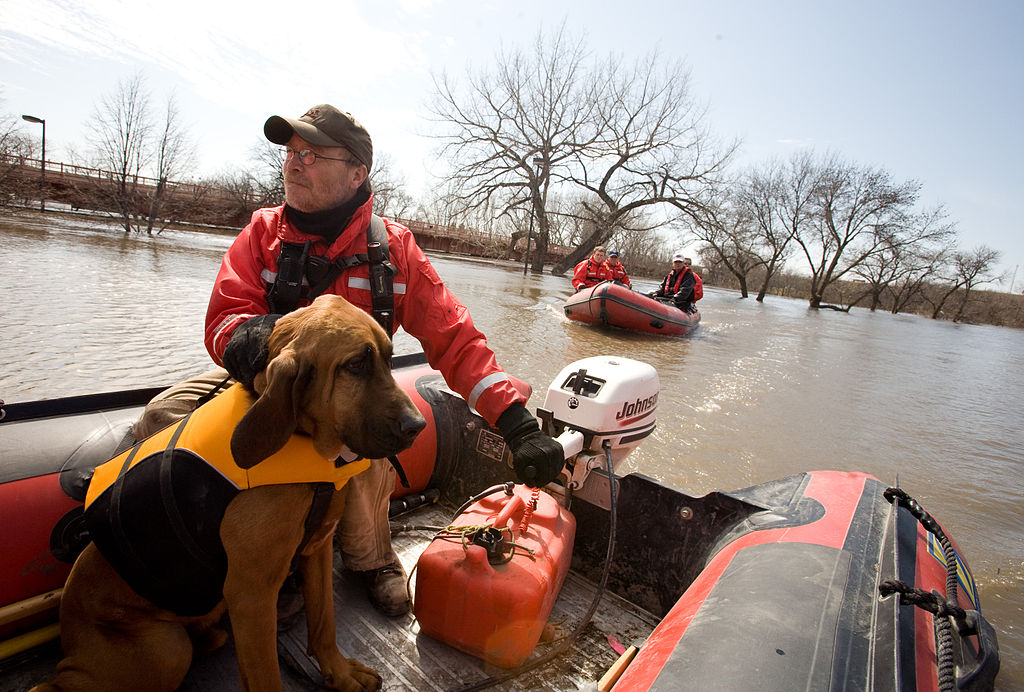 """Valley Water Rescue member, Mike Knorr and search dog, """"Barnaby"""" – image from FEMA Photo Library"""