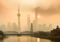 Shanghai Financial Center and modern skyscraper city in misty go