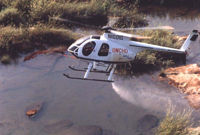 Helicopter spraying larvicides on breeding sites of the blackfly in West Africa