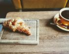 pastry-bread-beside-brown-ceramic-teacup-with-coffee-3172623