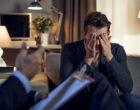 Psychologist interviewing depressed patient.