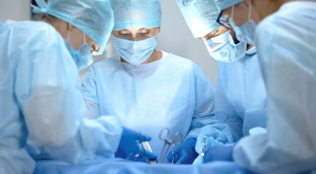 Operating team performing surgery in a modern hospital